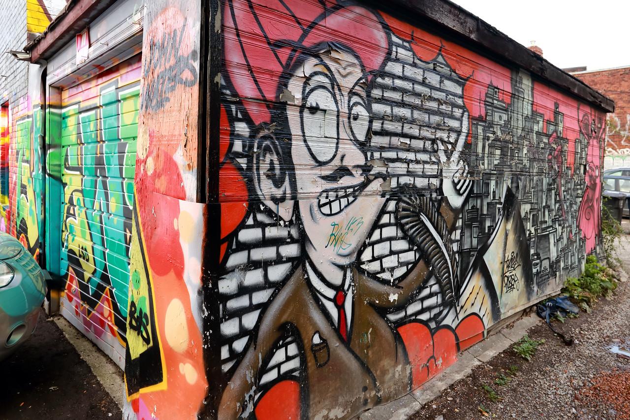 Graffitti adorns a garage in Toronto, Canada