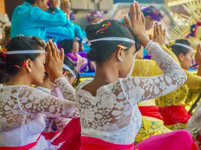 Hindu worshippers wearing traditional ceremonial clothing during a Balinese festival.