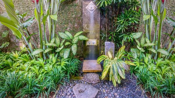 Tropical outdoor shower in a private villa in Bali.
