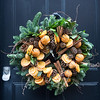 The oranges in this Christmas wreath, on a door in Princelet Street, were real.