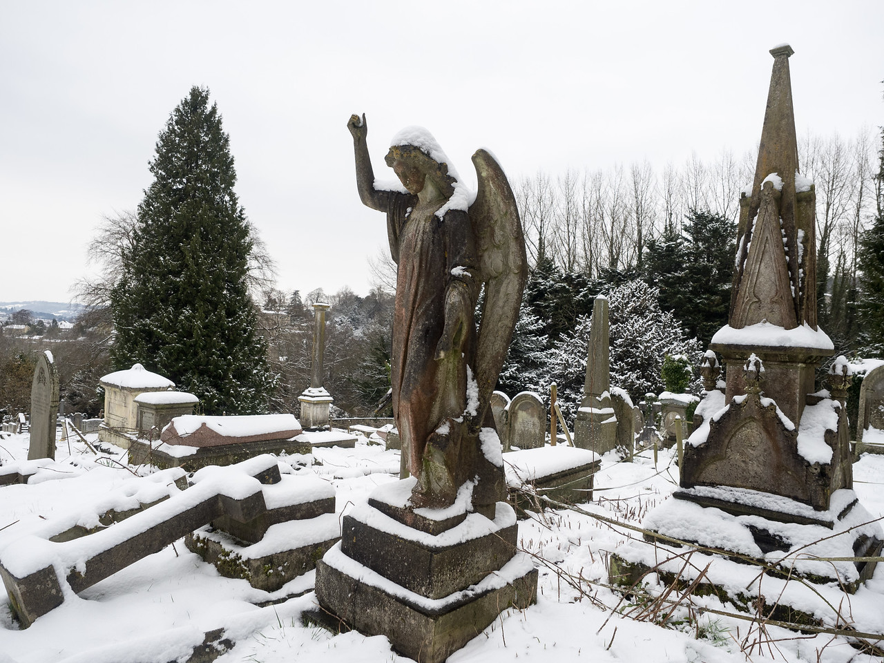 Angel in the snow, in the graveyard of Bath Abbey.