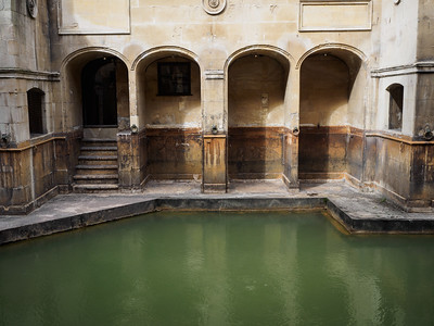 """The Sacred Spring that feeds into the baths. Offerings were thrown into the water -  more than 12,000 Roman coins were recovered. People also threw """"curse"""" tablets in the water - bits of lead inscribed with the names of people suspected of having stolen something (such as an item of clothing) or having committed some other crime."""