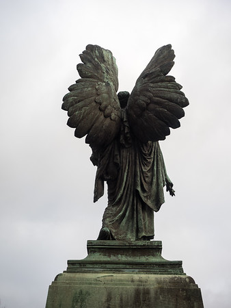 An angel sculpture in Parade Gardens, by the river.