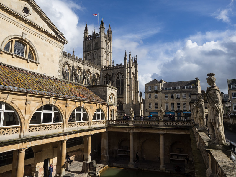 The Roman Baths, with Bath Abbey in the background. The upper levels of the building and the statues are Victorian.