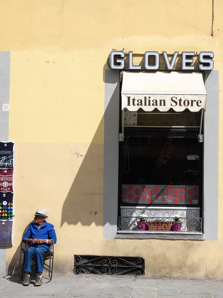 An elderly man enjoying the sun near Santa Croce.