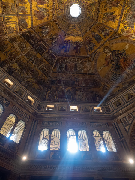 Inside the ancient Baptistery, the oldest building in Florence, with sun rays streaming in. It was all a bit Dan Brown.<br /> <br /> More pictures under 2 below