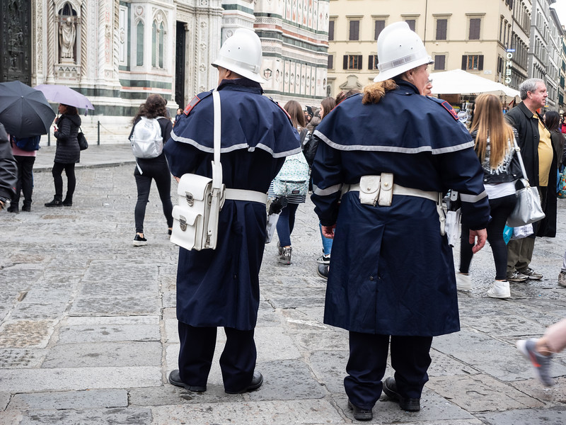 I'm assuming these were for tourists.They look like toy police, until you notice their guns...