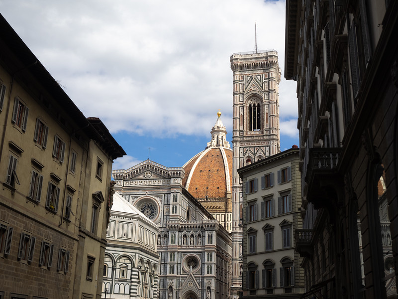 The Duomo can be glimpsed from many streets in Florence .