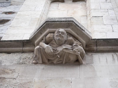 W B Yeats (or someone who looks like him) really seems to be enjoying whatever it is he's doing here; a stone carving in the Grand Place in Brussels.