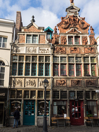Ornately decorated houses in the Kraanlei area of Ghent. The house on the left has panels illustrating various acts of mercy (visiting the sick, burying the dead, and so on). The house on the right has panels illustrating the five senses.