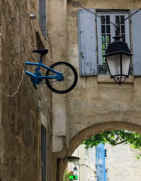 Just a bike sticking out of a wall... no big deal