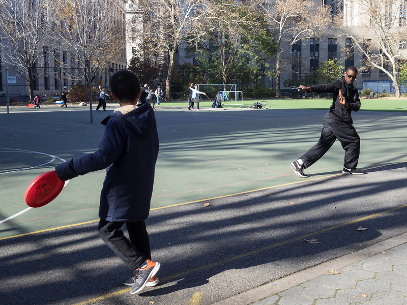 Tai Chi exercises (with sword) and frisbees in Chinatown.