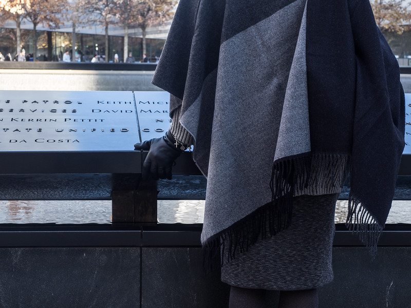 This woman was gripping the edge of the memorial very tightly. Perhaps she had lost someone in 9/11.