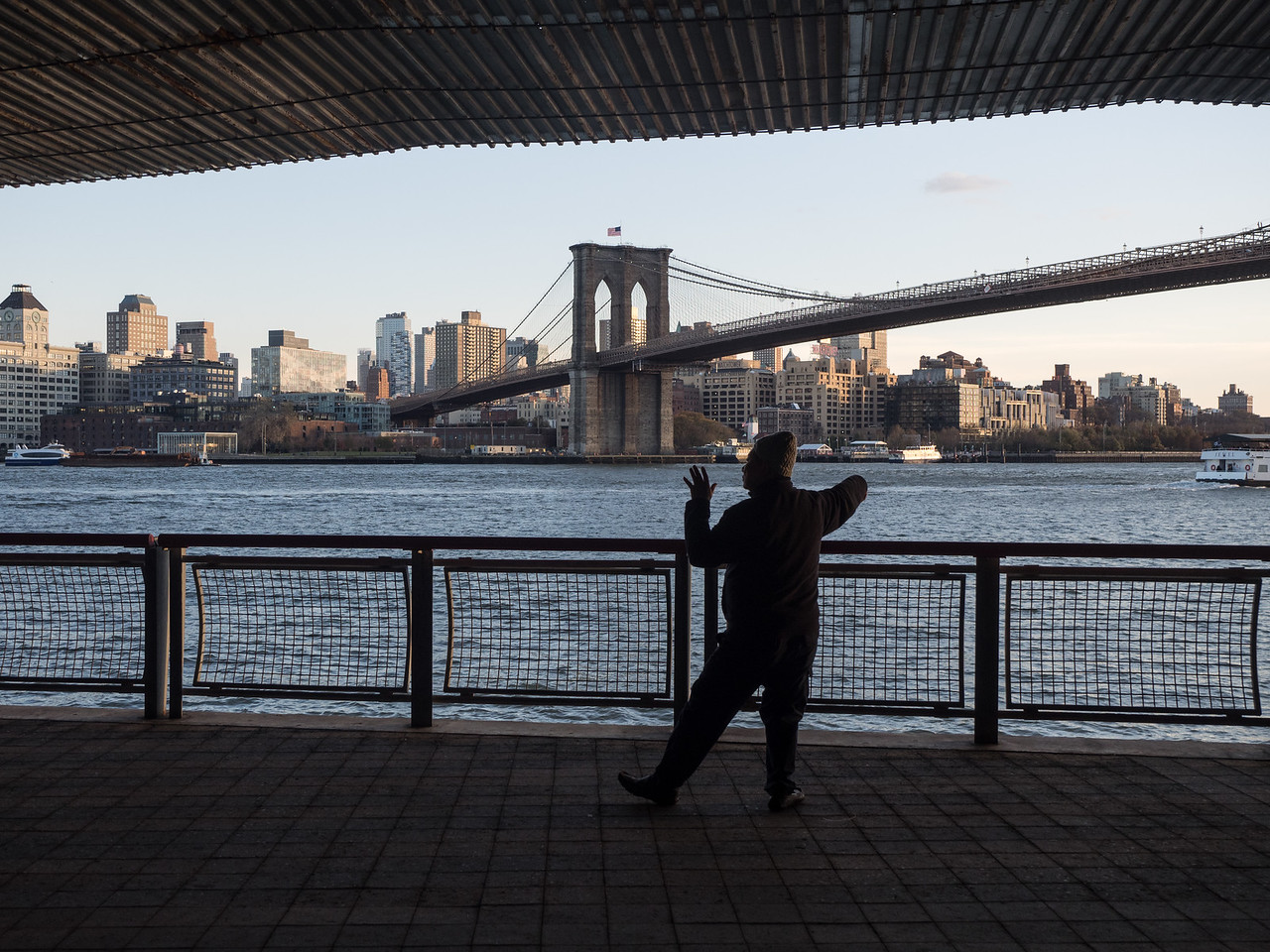 This Chinese man was practising his Tai Chi under a road bridge, looking across at Brooklyn.
