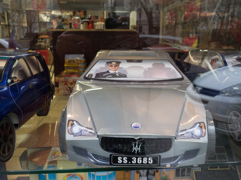 In the window of a traditional funerary shop in Chinatown - I think these cardboard  cars are bought to be burnt as offerings to the dead.