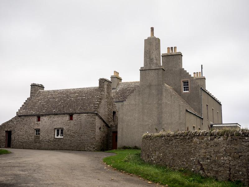 A formidable old farm building.