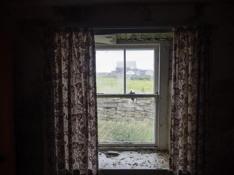 Still curtains on the windows.