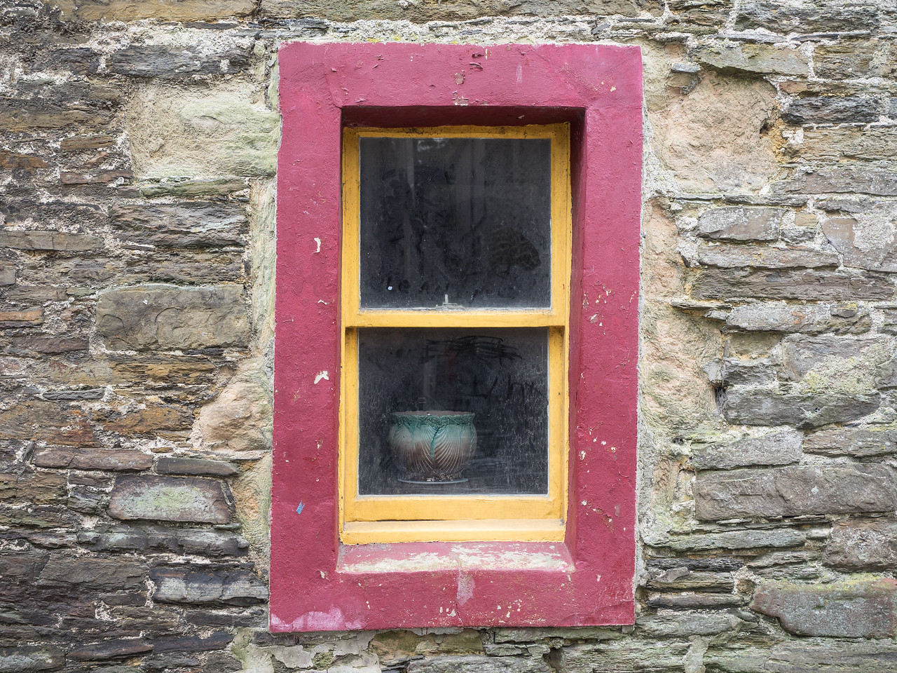 An interesting window and even more interesting pot, on the main street in Kirkwall.