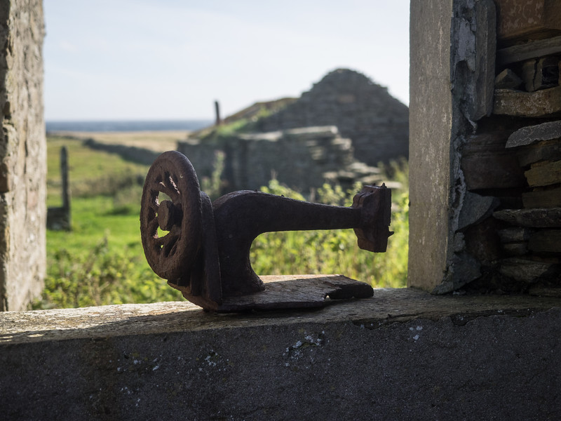 An old sewing machine in another abandoned croft.