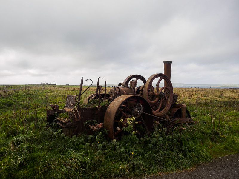 Some old contraption in a field.