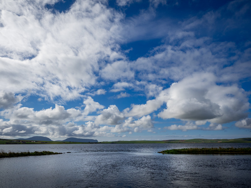 Sky and water all around, at the Ring of Brodgar.