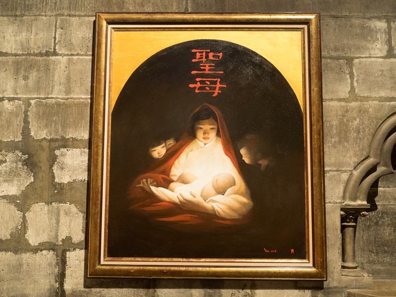 In Notre Dame,  a striking Chinese painting in one of the side chapels. I think this is associated with the Chinese martyr Saint Paul Chen, as there are some of his relics in this chapel.