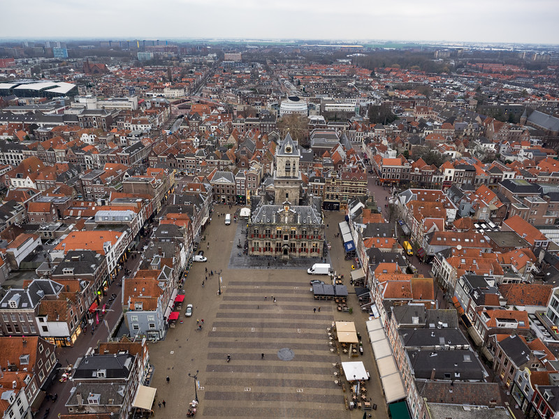 "A view of Delft from the tower of Nieuwe Kerk (the new church - it actually dates to the 14th Century). The building in the centre is the townhall. The staircase up this tower was unbelievably narrow, with lots of traffic jams as you encountered people coming the other direction. It made me think of a certain scene in ""In Bruges"" involving elephants..."