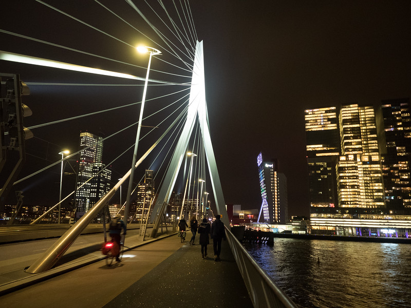Crossing the Erasmus bridge at night. The De Rotterdam building is on the right.