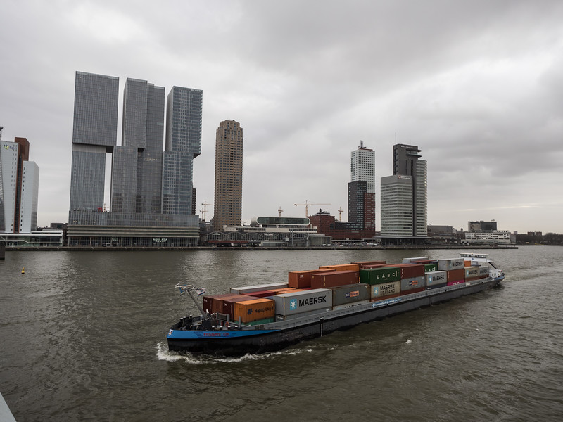 Lots of container ships sail up and down the river. Rotterdam is the busiest port in Europe (and a few years back it was the busiest in the world,  before being overtaken by Singapore and Shanghai).