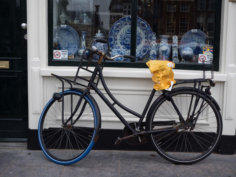 The city of Delft, famous for its pottery, is only 10 minutes away from Rotterdam by train. You can see some antique examples of Delftware in the shop window here (I also like the way the person who left the bicycle is completely ignoring the signs).<br /> <br /> There are two potteries still in Delft making the traditional pottery (most of the stuff in the shops is mass-produced in China). I visited one,  De Delftse Pauw, and got a tour around the factory (and bought a traditional Delftware blue and white tile, which I'm not quite sure what to do with).