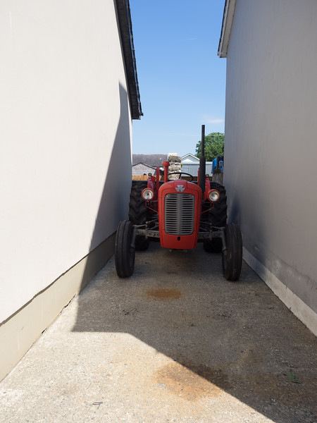 A narrow space for the tractor, just off the main street in Gortin.