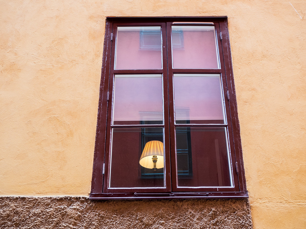 An interesting window and reflections, in Gamla Stan.
