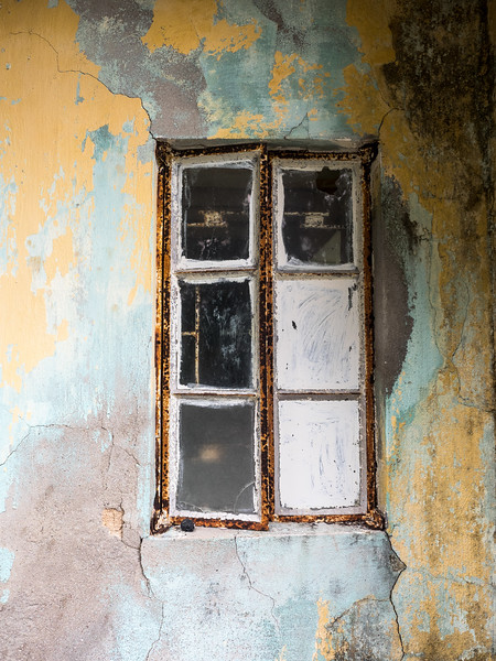 Beautiful patina of colours around this old window.