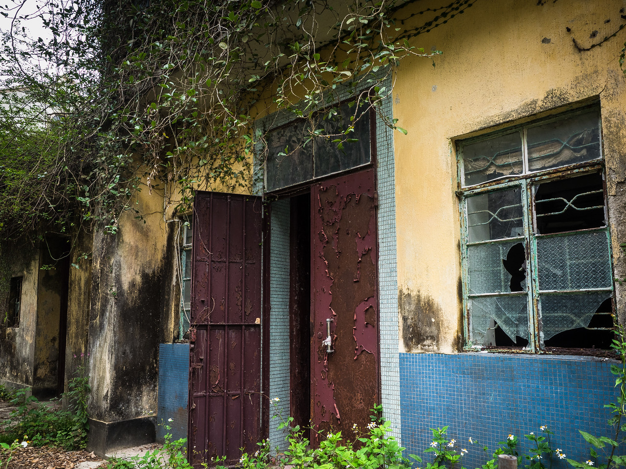 Many of the buildings are lying open and derelict like this.