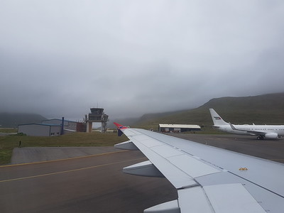 The main - in fact, only - airport in the Faroes. The approach was quite scary - we seemed to fly very close to mountains shrouded in clouds and fog. Fog in summer causes a lot of problems here; earlier in the week a football team from Montenegro got stuck in the airport for hours after fog closed in.  The original airport was actually built by the British army when they occupied the islands during World War 2 (after Denmark fell to the Germans).