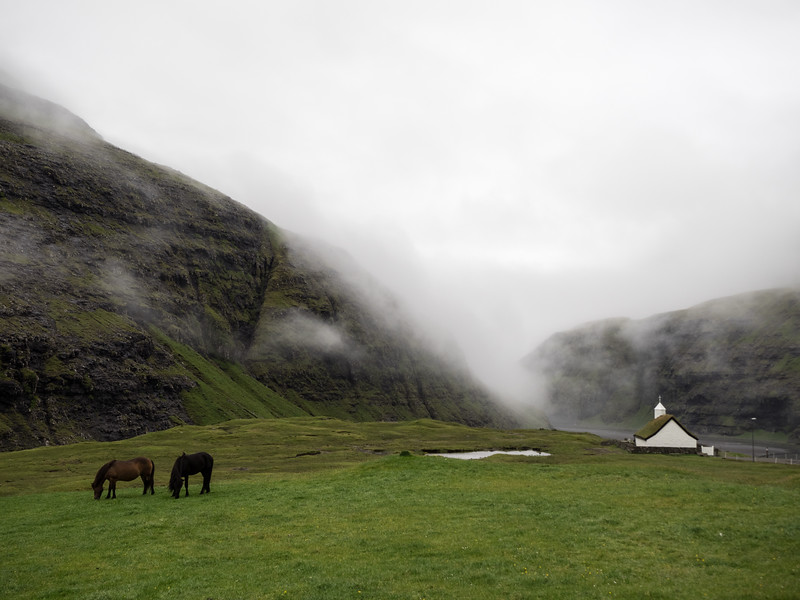The wonderfully remote old church at Saksun. This was at the end of a long, desolate-feeling valley, very atmospheric with the mist swirling across the mountains.