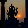 Deity Vishnu at sunset