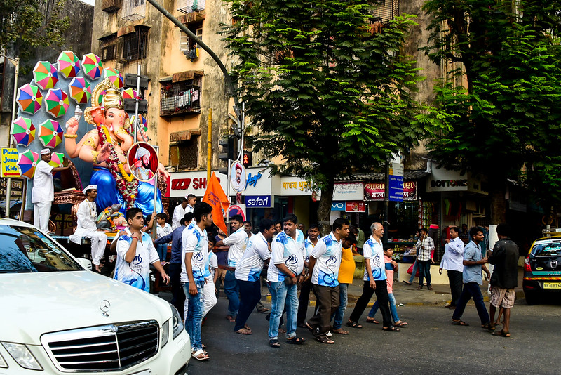 Ganesh parade in Mumbai - love the backdrop and the mercedes