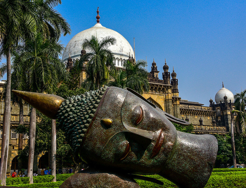 Mumbai's CSMVS Museum with large head statue on front lawn
