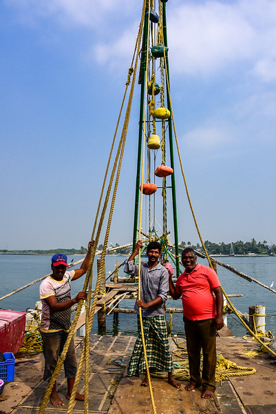 Cochin - a French fishing net team, with coloured counter weights
