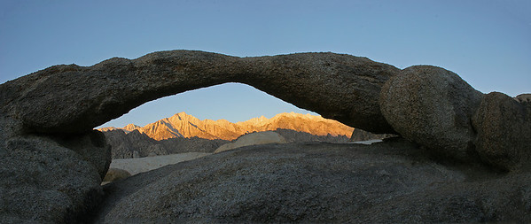 A multi-image panorama of Lathe Arch at sunrise.  One has to crawl down in a little ditch next to the arch to get this shot.  My lens is only about 3-4 feet away from the arch for this capture.