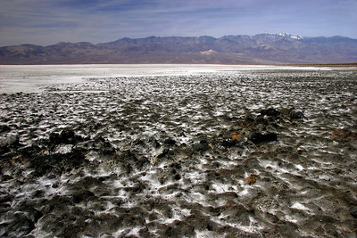 Badwater is 283 feet below sea level.  Salts from the surounding terrain are deposited there when runnoff rain evaporates away.