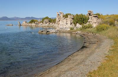 """Tufa towers along the beach of """"South Tufa""""."""