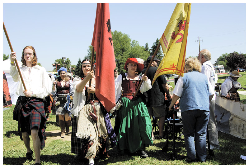 The start of festivities started with a small parade. The men wearing kilts, women in Renaissance clothes.