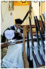 A young man busily oiling the guns. Most are authentic replicas of the old guns.