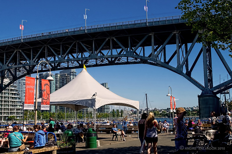 The outdoor dining area at Granville Public Market with Granville Street bridge above.