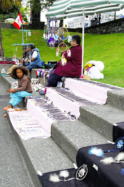A young vendor selling eskimo items.