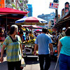 Beth shown here on the right hand side as she slowly walks towards the start of the open air street market in Taipei..