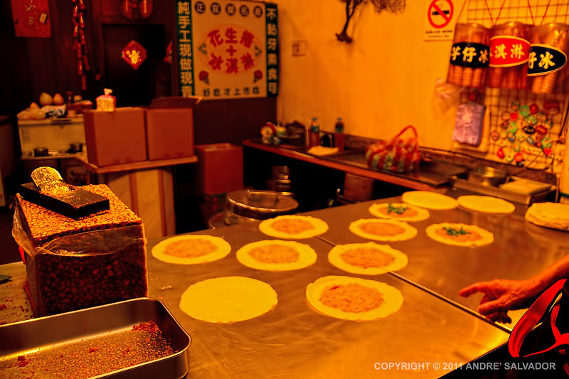 """This is a good """"eat"""". Flour tortilla like wrap, shaved sugared peanuts, cilentro at center, two scoops of ice cream, then wrapped like a Chinese spring roll. Try it if you ever visit this place."""