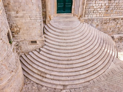The medieval semi-circular stone staircase outside the entrance to the Dominican Monastery in the Old Town of Dubrovnik.